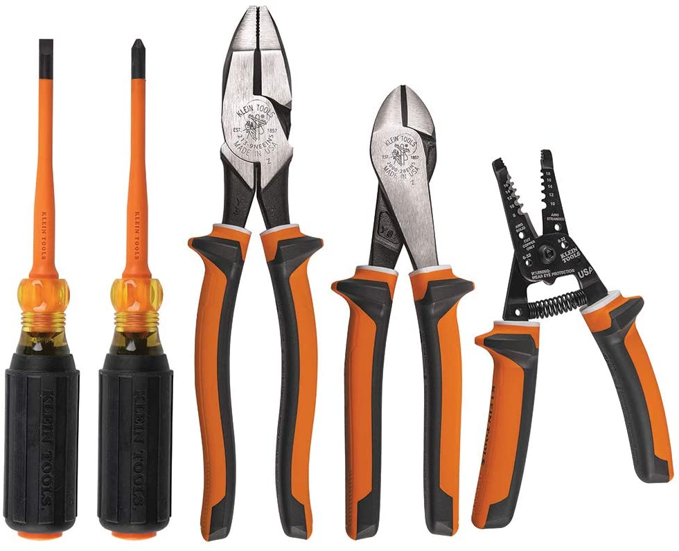 A set of klein tools including insulated screwdrivers pliers and wirecutters
